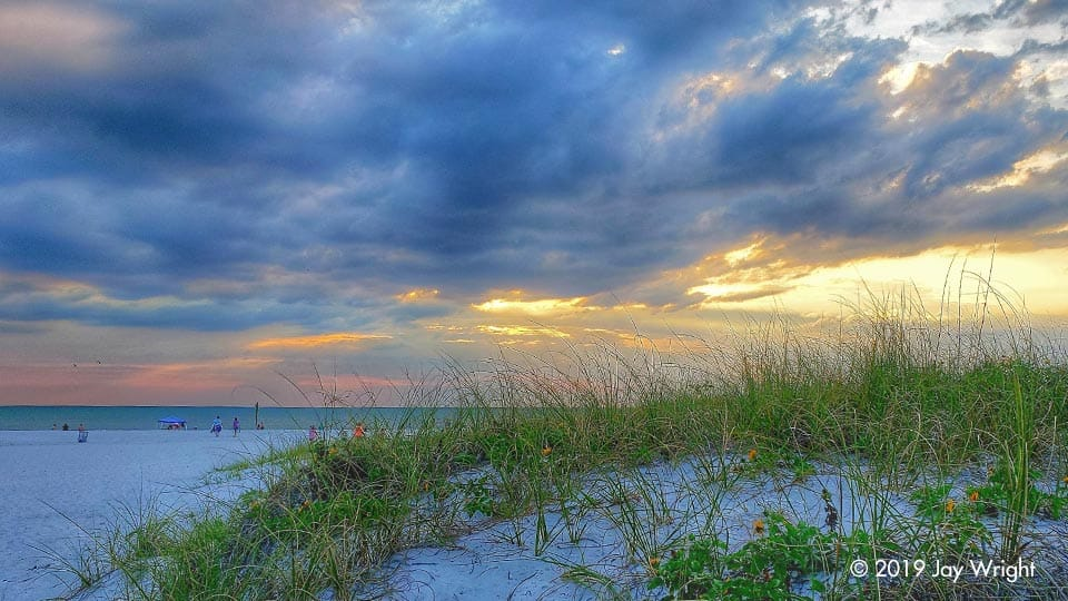 An idyllic setting ... sand dunes, sea oats and restless clouds, leaving one to wonder ... will we see the sun set tonight?